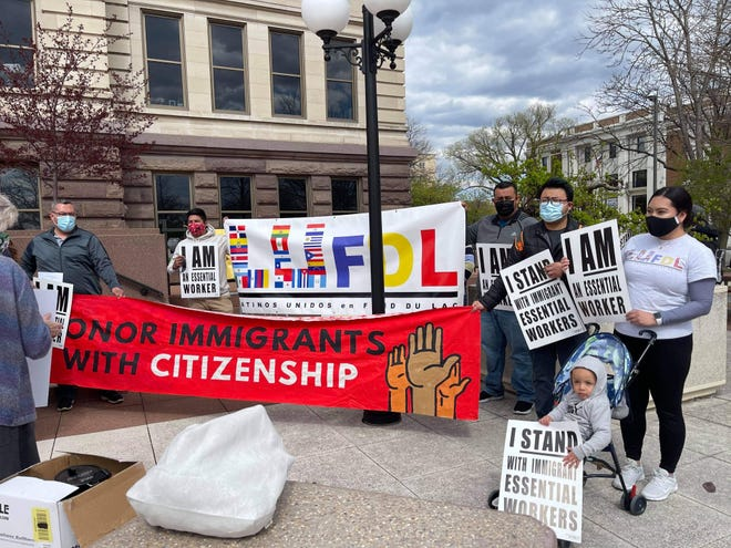 Members of Latinos Unidos Fond du Lac, from left: Hiram Rabadan, Juan Mojica, Victor Rabadan, Vicente Lezama Morales and Paola Rabadan attend a rally in Green Bay to support citizenship for immigrants and protect undocumented Latino essential workers.