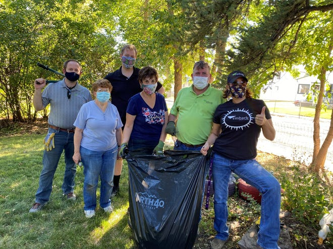 Volunteers pose after helping to clean during NeighborWorks' 2020 event.