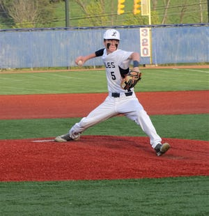 Lancaster senior pitcher Trevor Roby gets set to deliver a pitch against Fairfield Union Tuesday night at Beavers field. The Golden Gales pulled out a 3-2 win over the Falcons.