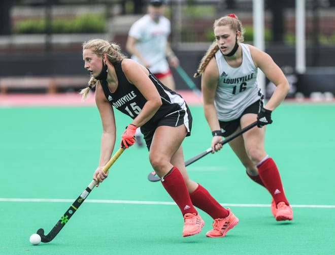 UofL field hockey player Emilia Kaczmarczyk, left, moves the ball up the field as teammate Maitland Demand pressures during a practice Wednesday morning. The Cardinals are the overall No.3 seed in the 2021 NCAA Championship. April 28, 2021