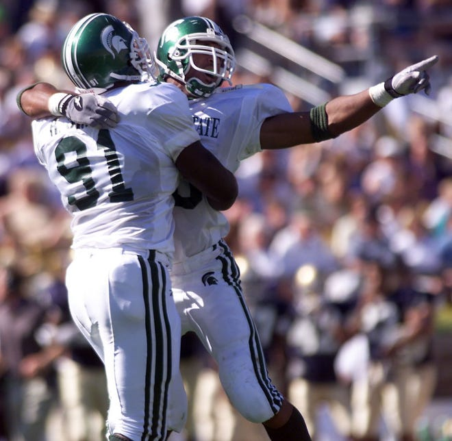 Robaire Smith (91) and Julian Peterson celebrate, here in 1999  celebrating after sacking Notre Dame's quarterback and causing a fumble, were part of MSU's illustrious 2000 NFL draft class, both with long NFL careers.