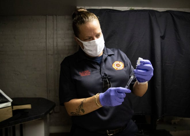 Memphis Fire Department Katrina Stewart draws the COVID-19 vaccine from an ampule into a syringe at Serenity Recovery Center on Wednesday, April 28, 2021.