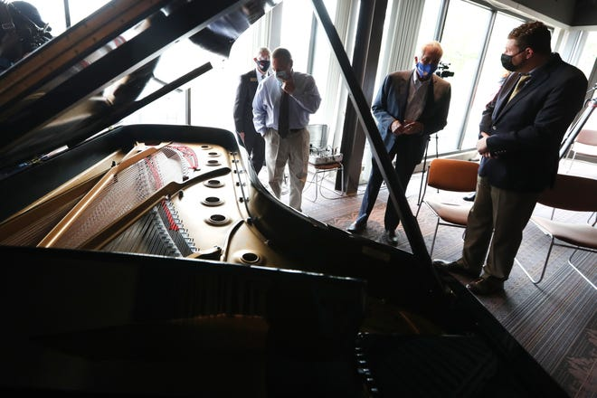 Memphis-based AMRO Music celebrated its 100-year anniversary with an unveiling of a 9-foot Steinway & Sons piano, vinyl-wrapped with a design custom-made by Ferocious Graphix, at their Midtown store on Wednesday, April 28, 2021.