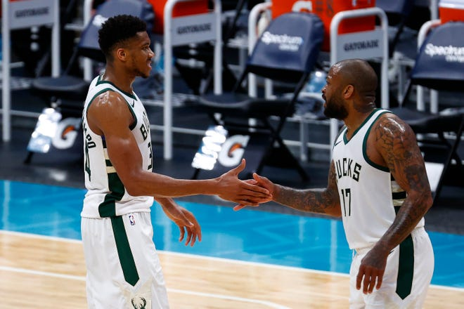 Giannis Antetokounmpo (left), P.J. Tucker and the Bucks have two games left in the regular season, on Saturday and Sunday.