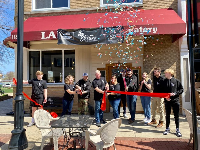 Members of the Etcetera Bar and Grill celebrate the restaurant's opening April 17.