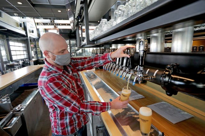 Good City Brewing co-owner David Dupee pours a beer at the craft brewery's Wauwatosa location in April. The craft breweryannounced Wednesday it will commit at least 1% of its annual company revenue tosupporting nonprofits and programs that work to eliminate housing barriers.