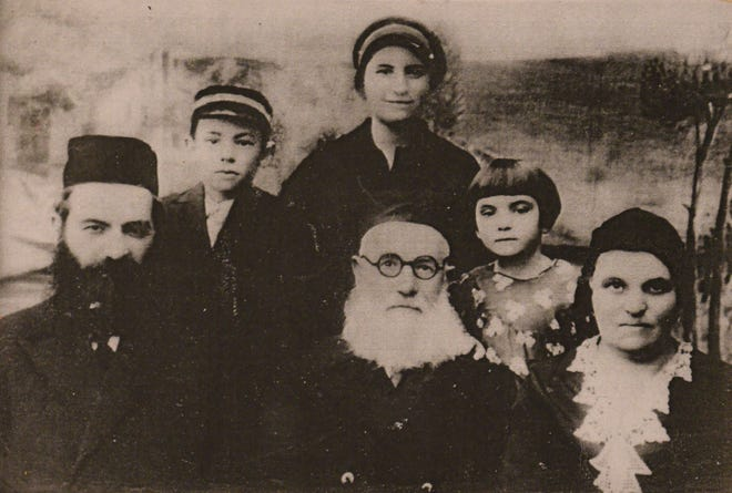 Bernstein's family portrait. She is pictured, second from right.