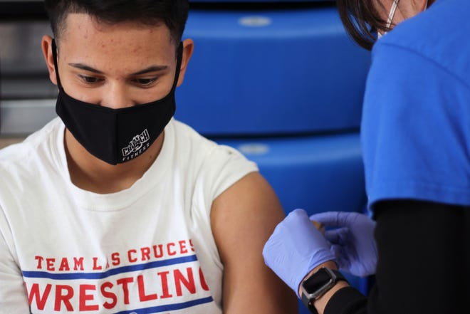Isaiah Carreon, a junior at Las Cruces High, receives his first dose of the COVID-19 vaccine at the Las Cruces Public Schools vaccine event on Wednesday, April 28, 2021.