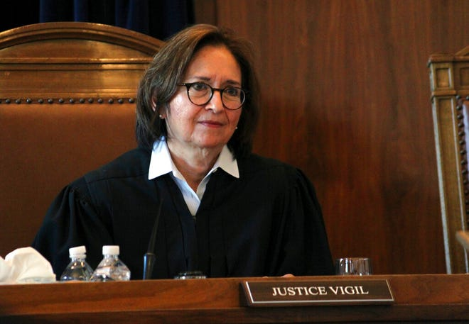 In this file photo from Wednesday, Jan. 29, 2020, New Mexico Supreme Court Justice Barbara Vigil listens to arguments in a case about the state's Energy Transition Act during a hearing in Santa Fe. Vigil is retiring from the New Mexico Supreme Court at the end of June 2021 after more than eight years at the high court.