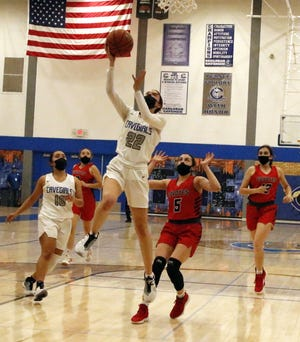 Carlsbad's Kilea Estrada gets a fastbreak layup against Roswell in the third quarter of Tuesday's district game. Estrada finished with 10 points and Carlsbad won, 56-21.