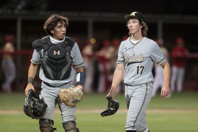 Xavier Prep's Alejandro Brito and Dylan Van Meeteren walk to the dugout in a game against Palm Desert on Tuesday, April 27, 2021, in Palm Desert, Calif.