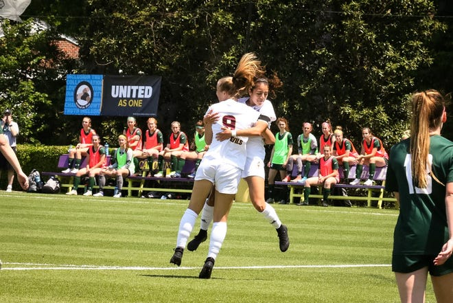 Nicole Douglas (9) celebrates her goal against Siena on Wednesday in the NCAA Tournament first round.