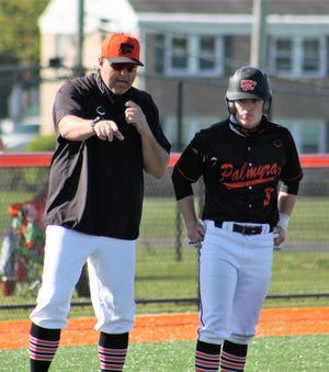 Palmyra baseball coach Neil Weber makes a point to baserunner Gavin Neal during the Cougars' 14-4 win vs. Bishop McDevitt last week. The Cougars won the Mid-Penn Keystone Division and have earned a 5A district playoff berth.