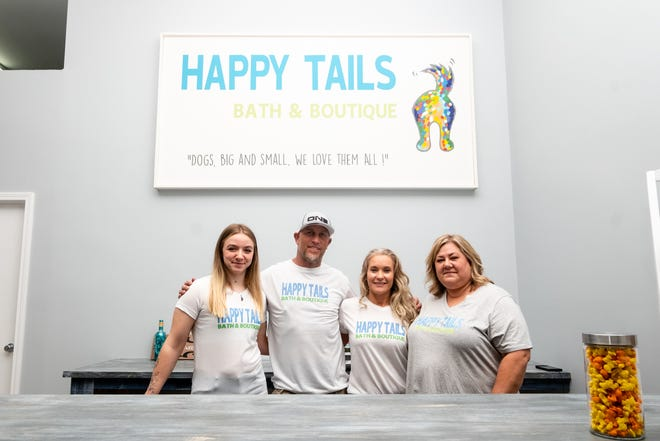 From left, groomer Madison Reed, owners Greg and Paula Bennert and manager Audra Carney pose for a portrait Wednesday, April 28, 2021, at Happy Tails Bath & Boutique in Fort Gratiot. The store will offer full-service grooming, self-wash dog stations and a boutique that carries new and gently used items.