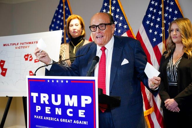 FILE - In this Nov. 19, 2020, file photo, former Mayor of New York Rudy Giuliani, a lawyer for President Donald Trump, speaks during a news conference at the Republican National Committee headquarters in Washington. A law enforcement official tells the Associated Press that federal investigators have executed a search warrant at Rudy Giuliani's Manhattan residence. The former New York City mayor has been under investigation for several years over his business dealings in Ukraine.(AP Photo/Jacquelyn Martin, File)