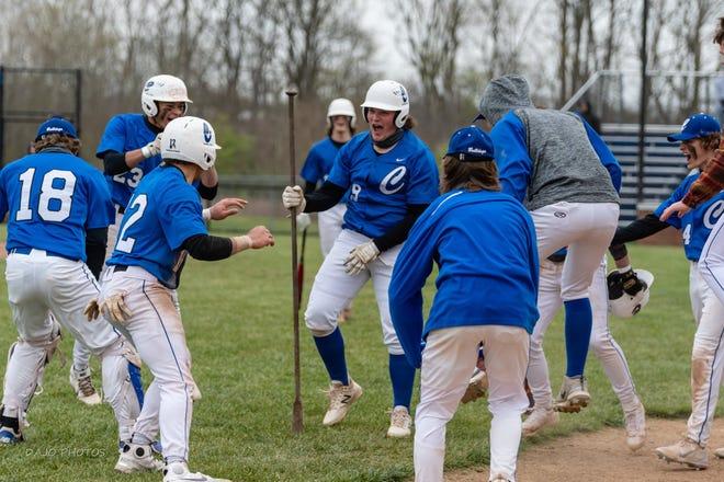 Centerville baseball celebrating its 21-1 home win over Rushville on April 20, 2021.