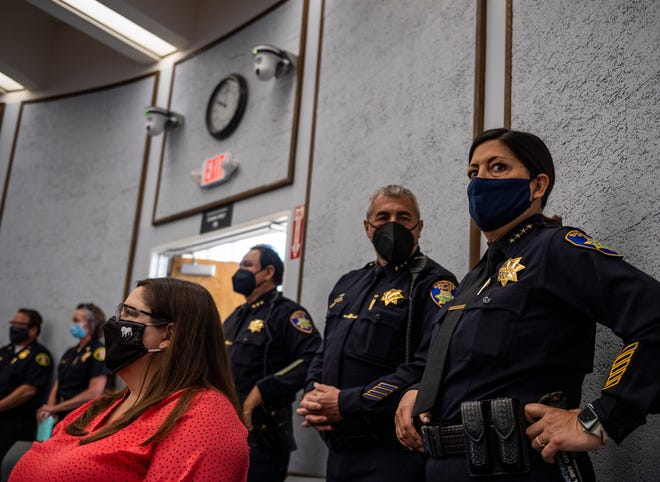 Salinas Police Chief Adele Fresé, right, stands tall next to her Assistant Police Chief Roberto Filice and Manuel Martinez Jr. during a press conference in Salinas Calif., on Wednesday, April 28, 2021.