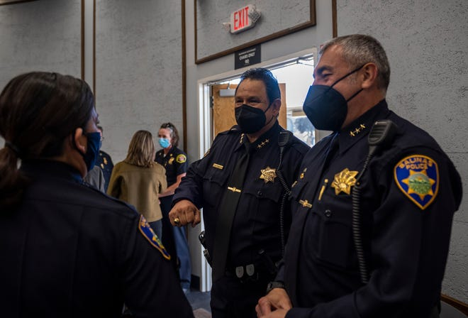 Salinas Assistant Police Chief Manuel Martinez Jr. fist bumps Police Chief Adele Fresé, during a press conference inside City Hall's rotunda in Salinas Calif., on Wednesday, April 28, 2021.