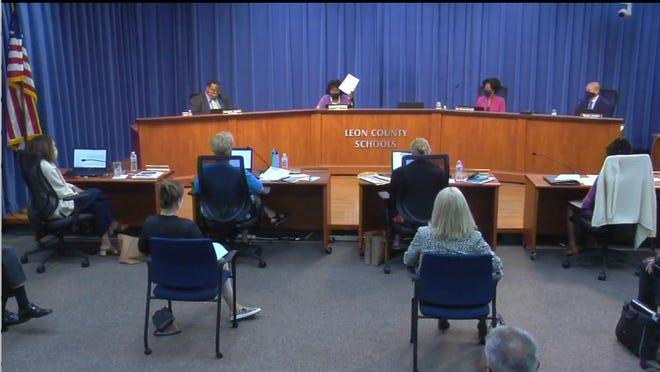 "School Board Chair Joy Bowen holds aloft Red Hills Academy charter school's application saying the document was ""weak."""