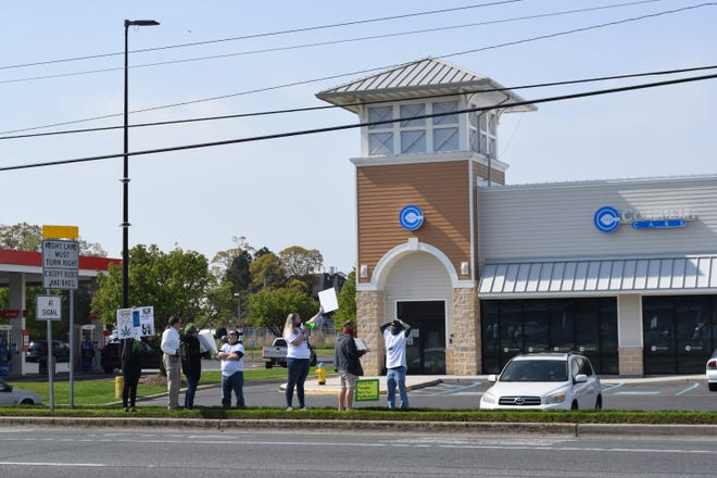 """A group of self-described """"medical cannabis patients, caregivers, and other pro-legalization cannabis advocates"""" staged a protest outside the Columbia Care dispensary on Route 1 in Rehoboth Beach April 24."""
