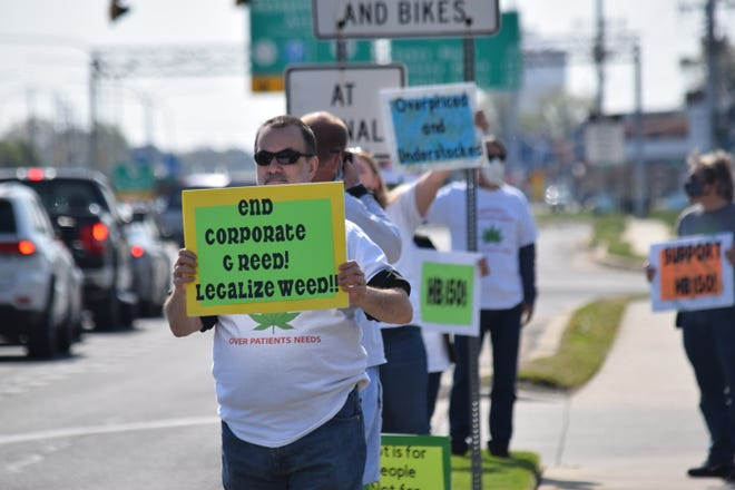 Robert Rey of Georgetown protested against the Columbia Care marijuana dispensary on Route 1 in Rehoboth Beach April 24.