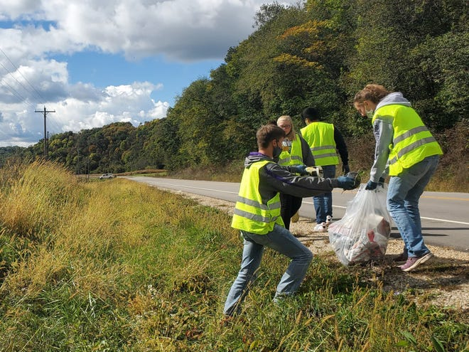 River Ridge members are hard at work cleaning the ditches of road on Highway 18 near Patch Grove, WI as part of their Adopt-a-Highway program. Numerous chapters in Wisconsin Adopt-a-Highway to volunteer their time to remove trash, recyclables and litter from highways through the Wisconsin Department of Transportation.