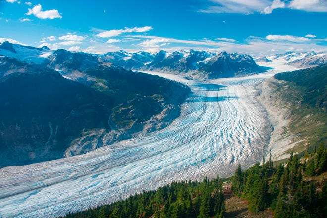 This September 2017 photo provided by researcher Brian Menounos shows the Klinaklini glacier in British Columbia, Canada. The glacier and the adjacent icefield has lost nearly 16 billion tons of snow and ice since 2000, Menounos says.