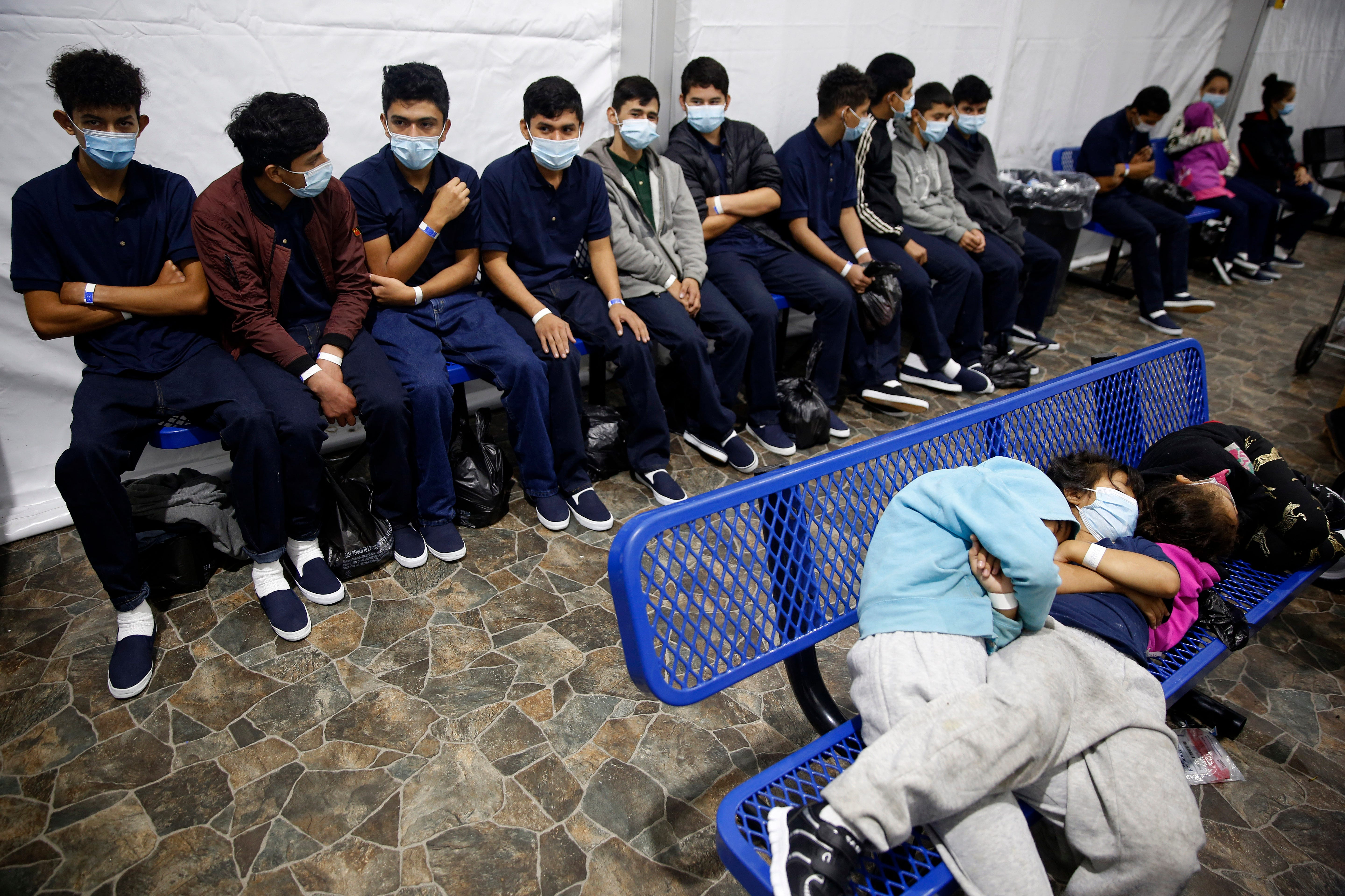 Immigrants waiting in a detention facility