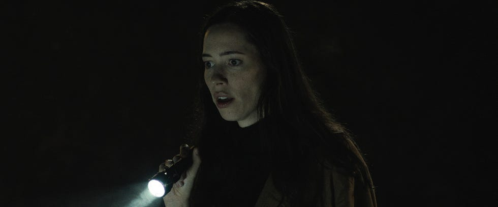 """Rebecca Hall stars as a widow whose husband has just died unexpectedly and now experiences visions living alone in the lakeside house he built for her in the psychological horror film """"The Night House."""""""