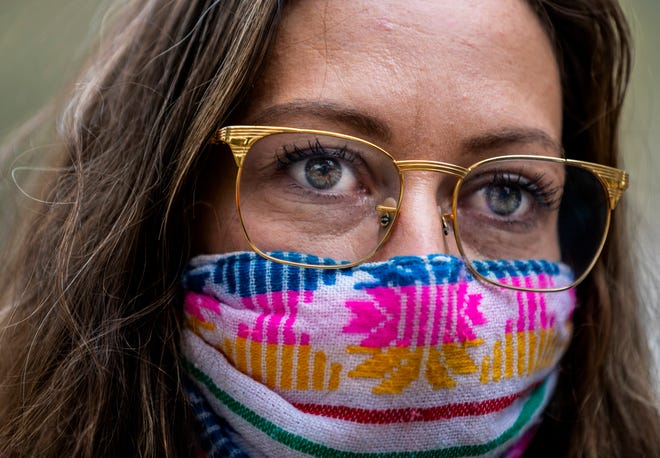 Crystal Maher joined other essential workers on Congress Avenue and East 11th St on March 8, to protest Governor Greg Abbott's executive order lifting the mask mandate in Texas.