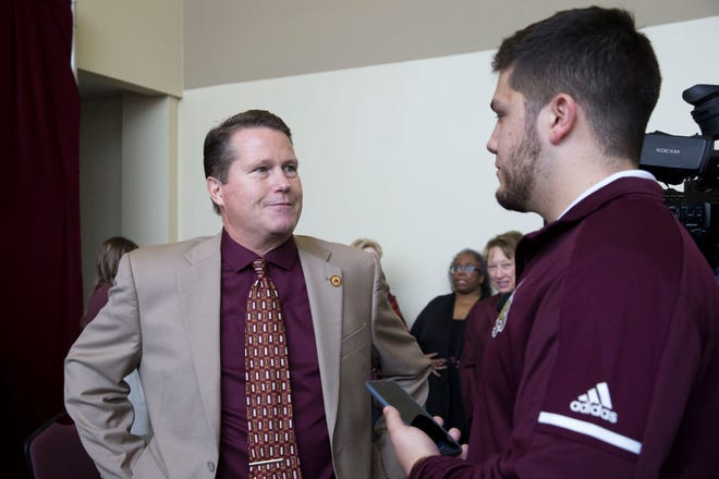Texas State athletic director Larry Teis, left, announced Thursday that he's stepping down from his position at the end of August. He'll serve as a special assistant to the university president for a year after that.