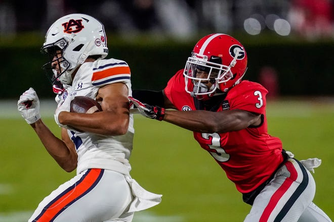 Auburn wide receiver Anthony Schwartz, left, has elite sprinter's speed but his former coach, Gus Malzahn, said he is not just a fast guy who plays football, he's a football player with track speed. [Dale Zanine/USA TODAY Sports]