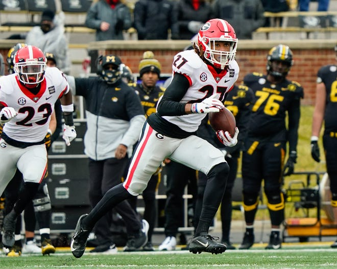 Dec 12, 2020; Columbia, Missouri, USA; Georgia defensive back Eric Stokes (27) returns an interception against the Missouri Tigers during the first half at Faurot Field at Memorial Stadium. Jay Biggerstaff-USA TODAY Sports