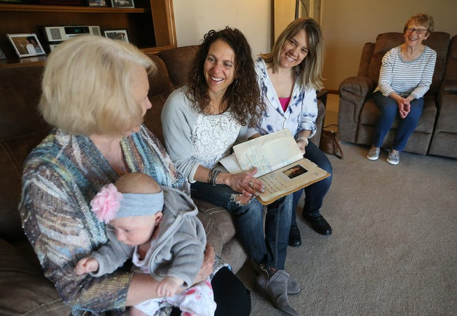Karen Postma Jones, left, reminisces April 26 with her former students Becky Bisesi Mocarski, left center, and Joan Cuffman Conner, right center, and Becky's mother Marci Bisesi in Wadsworth. Mocarski and Conner, who are both hearing impaired, were taught how to read lips by Jones.