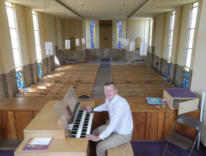 When Joe Breiding was an altar boy at Christ the King Catholic Church in Akron, the nuns wouldn't let children play the church organ. Now he owns the building.