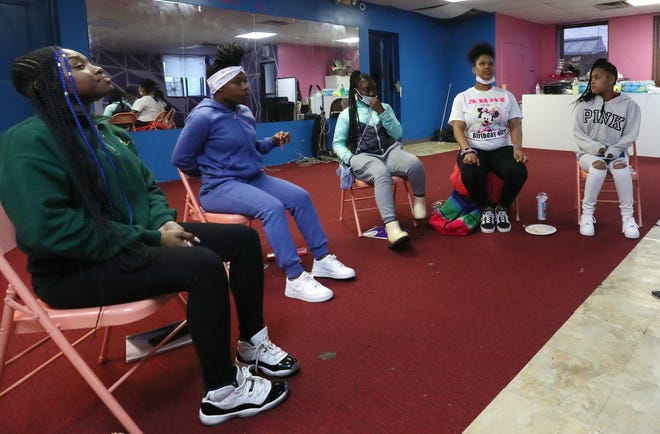 Young African American girls take part in a discussion during a meeting of Little Miss and Big Sis in Akron, Ohio, on April 22, 2021. The group is an empowerment program for young black girls that started in Akron last year.