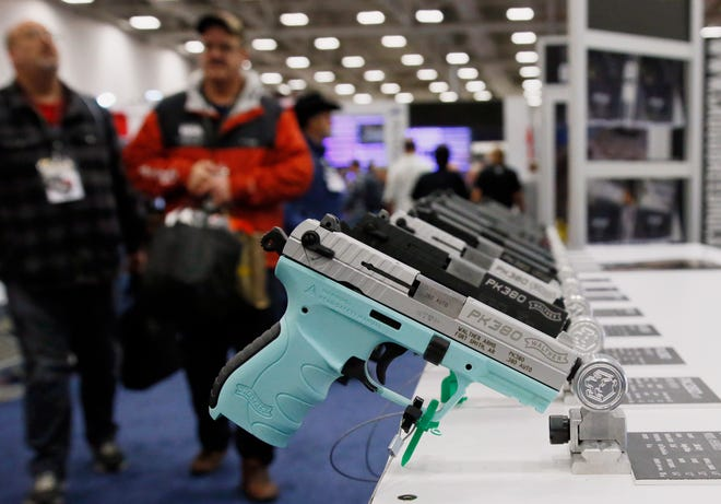 In this May 4, 2018, file photo, handguns are on display at the The National Rifle Association convention in Dallas. Texas is edging closer to becoming the largest state in the country to allow people to carry handguns without a license.