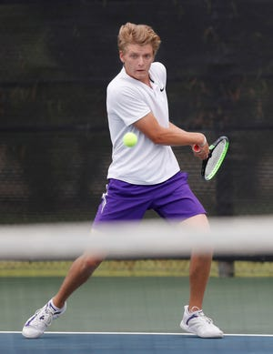 Canyon's Bryce Ware attempts a return during a Region I-4A finals match Thursday against Hereford's Luis Avila at the McLeod Tennis Center. [Mark Rogers/For A-J Media]