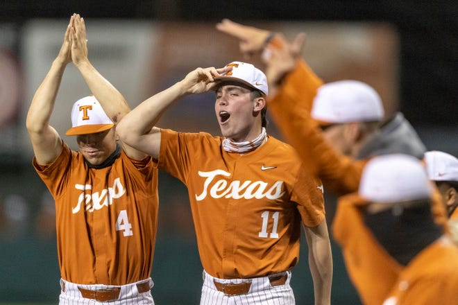 Texas catcher Silas Ardoin and pitcher Tanner Witt celebrate a win over Sam Houston State in Austin on March 9. The Longhorns are relying on a handful of talented young pitchers this season; Texas has the Big 12's best team ERA.