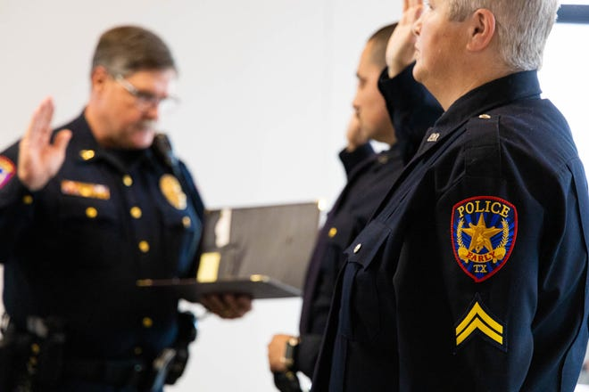 Early Police Chief David Mercer administers the Law Enforcement Oath of Honor at Tuesday's meeting of the Early City Council to officers Andres Contreras and Michelle Sheedy after the officers were promoted from the rank of corporal to sergeant.