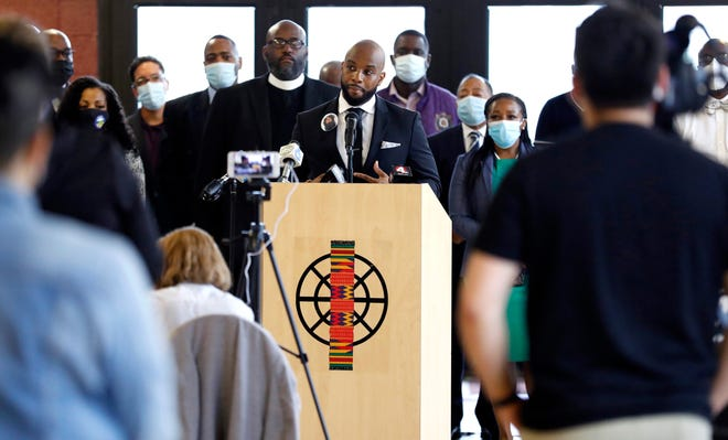 Sean Walton speaks at a news conference Thursday to announce The Columbus Police Accountability Coalition will release a formal demand letter to the U.S. Department of Justice regarding what it called the Columbus Division of Police's history of violence and misconduct.