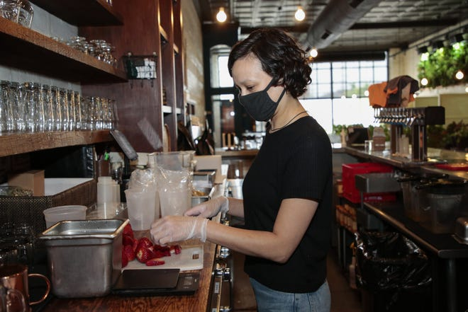 Alisha Kaplan, bar manager at Wolf's Ridge Brewing taproom Downtown, has had to take on additional job responsibilities like many who work at bars and restaurants. Waiting on more tables can mean more tips, but not being able to give customers as much attention can also result in lower gratuities.