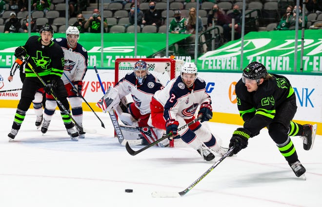 Andrew Peeke (2)  of the Blue Jackets defends against Dallas forward Roope Hintz in an April 17 game.