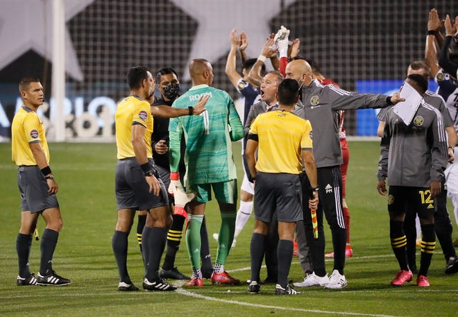 Columbus Crew SC head coach Caleb Porter yells at head referee Juan Calderon following the first leg of the CONCACAF Champions League quarterfinals at Crew Stadium in Columbus on Wednesday, April 28, 2021. The teams tied 2-2.