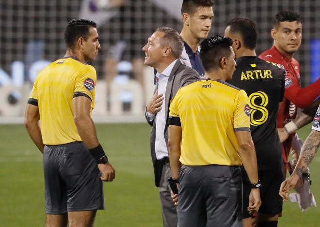 Crew coach Caleb Porter has a few words for referee Juan Calderon, left, after the Crew and CF Monterrey played to a 2-2 tie on Wednesday in the first leg of a CONCACAF Champions League quarterfinal at Crew Stadium.