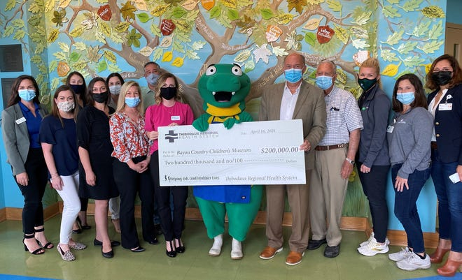 Officials from Thibodaux Regional Health System and the Bayou Country Children's Museum  celebrate the donation and partnership.