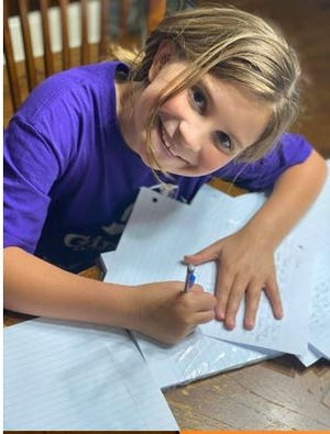 A Girls on the Run Bayou Region participant writes a letter to frontline workers dealing with the COVID-19 pandemic.