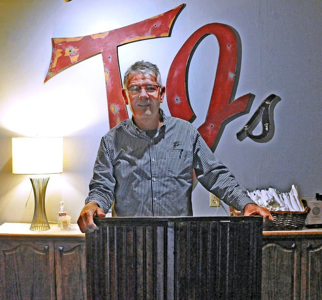 Greg Tieche at  the entrance to TJs restaurant in downtown Wooster.