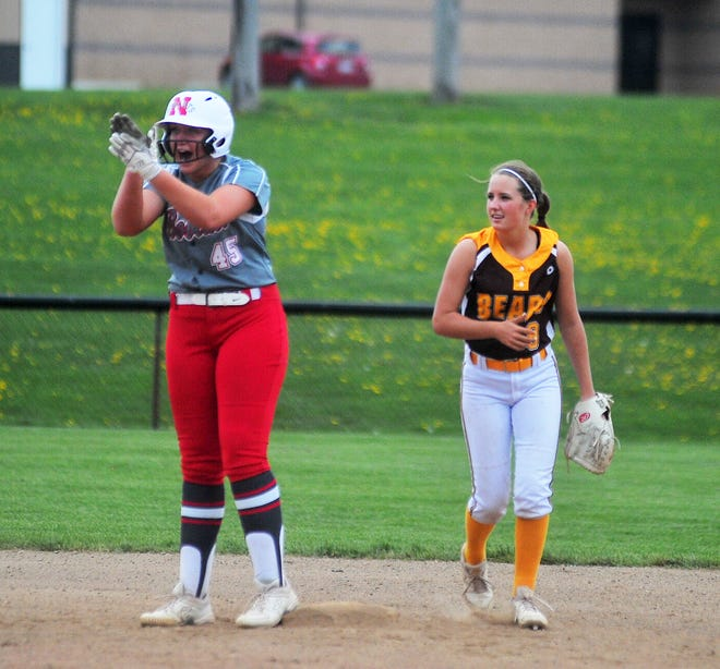 Norwayne's Kennedy Kay celebrates with her team at second after a double.
