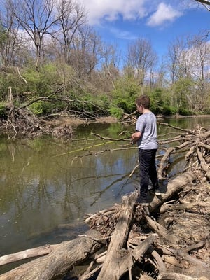 Conor Kanode, grandson of outdoor correspondent Art Holden, fishes Alum Creek in central Ohio for spawning white bass.